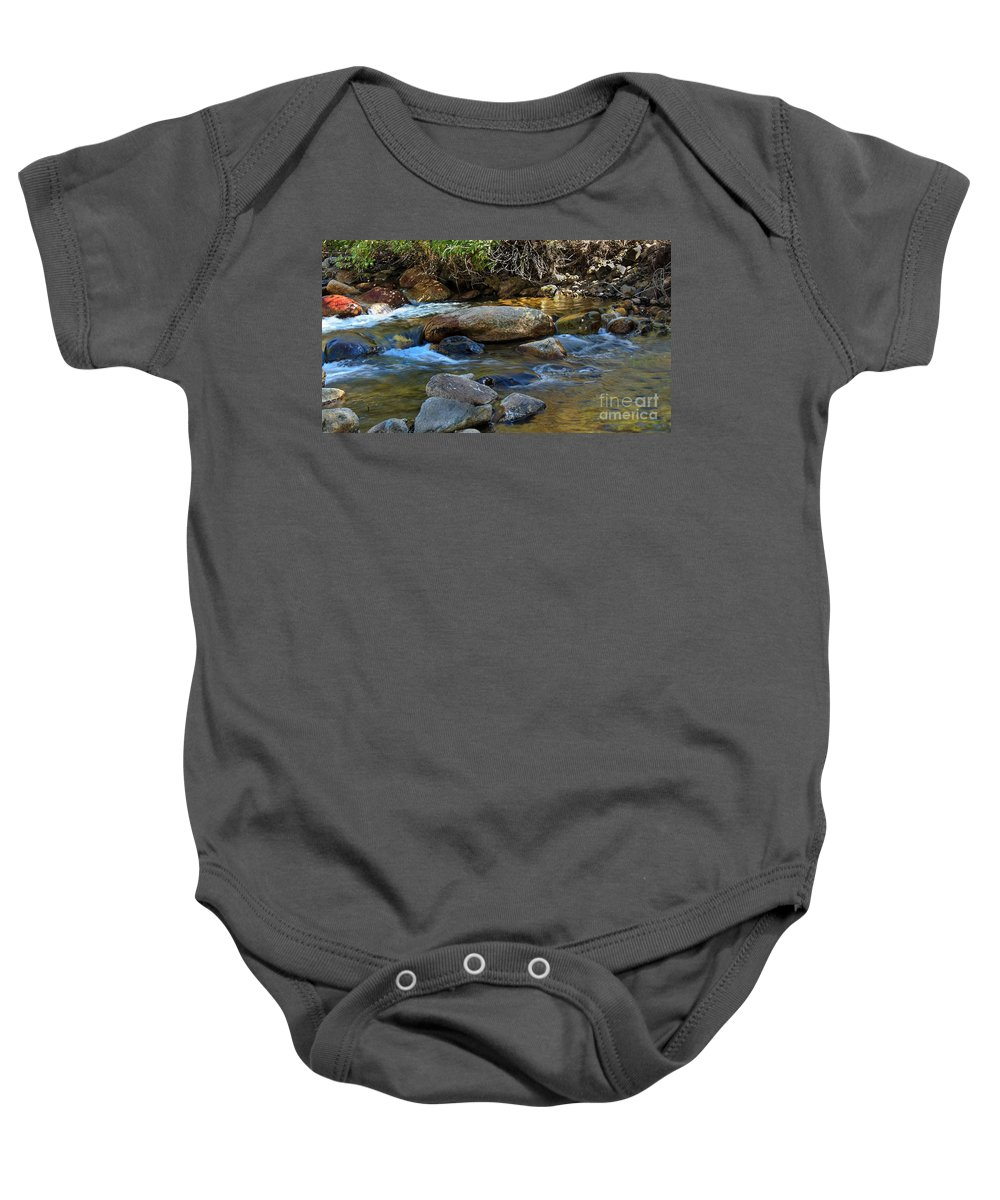 Stream Baby Onesie featuring the photograph Rushing Mountain Stream by Robert Bales