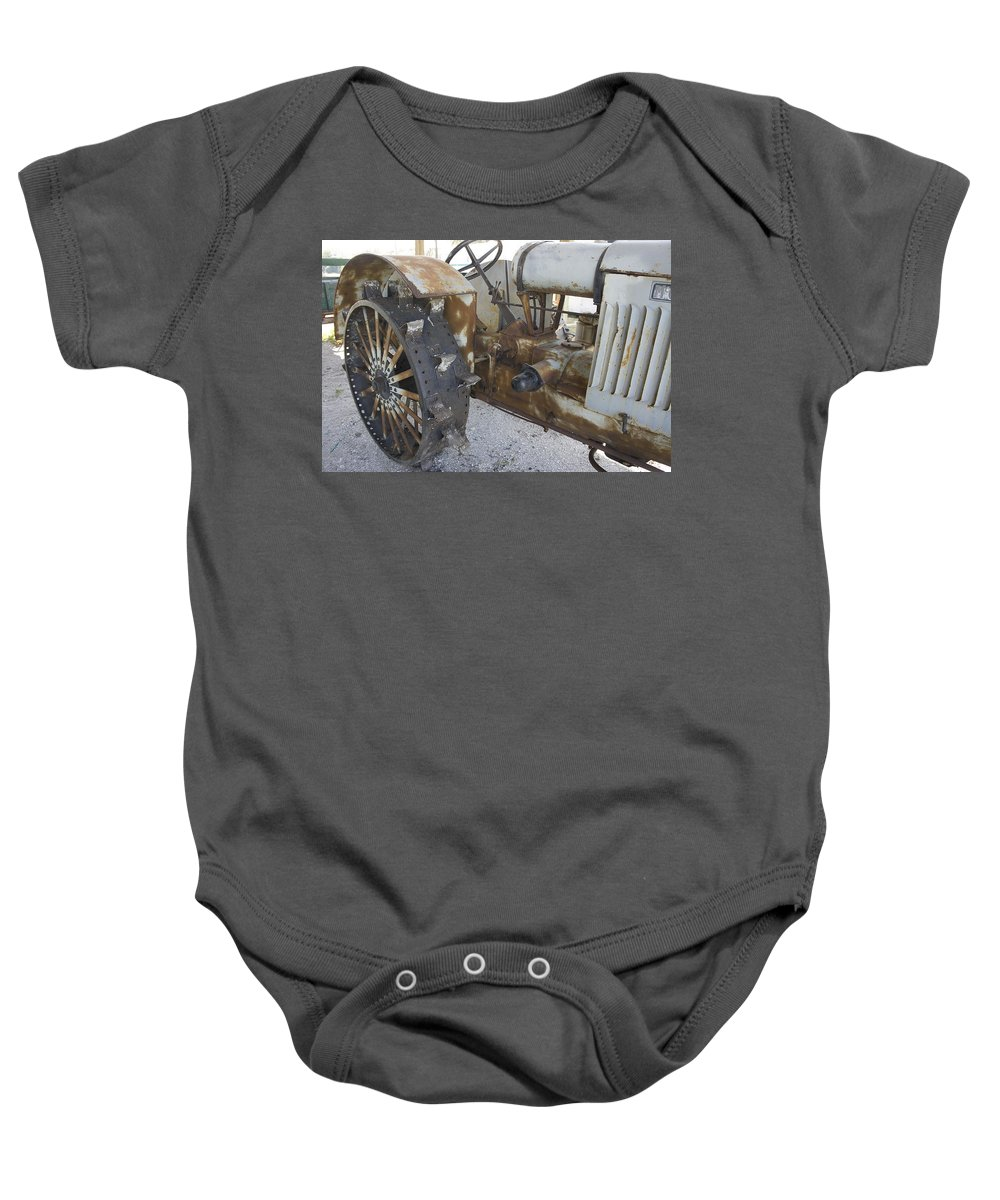 Tractor Baby Onesie featuring the photograph Rusty Tractor by Laurie Perry