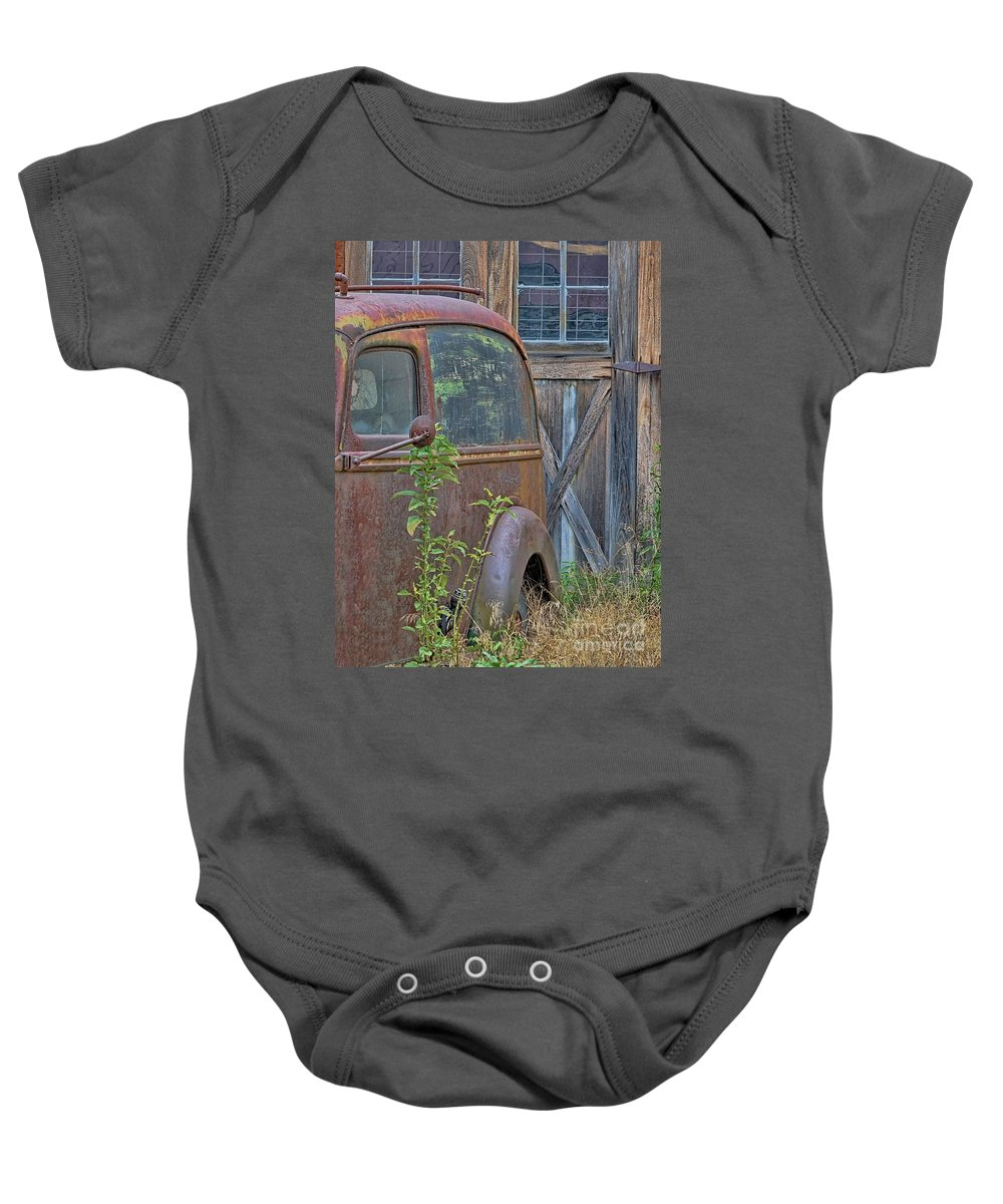 Rusty Vintage Ford Panel Truck Baby Onesie featuring the photograph Rusty Vintage Ford Panel Truck by Liane Wright