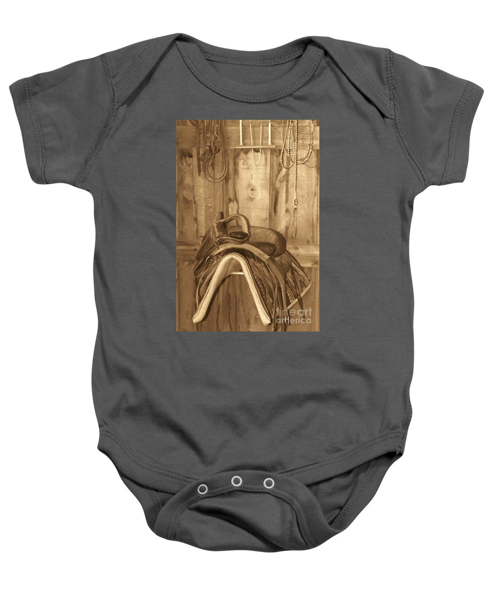 Saddle Baby Onesie featuring the photograph Saddle by Brandi Maher