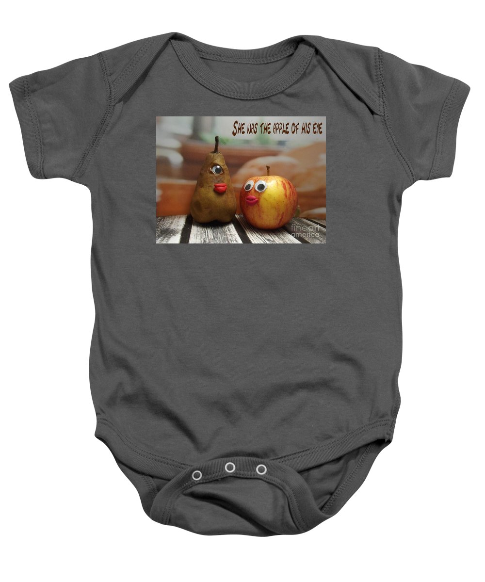 Funny Fruit Photograph Baby Onesie featuring the photograph She Was The Apple Of His Eye by Caroline Peacock