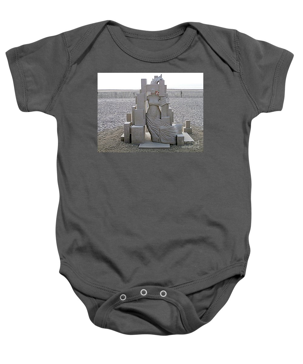 Sand Castles Baby Onesie featuring the photograph She's Come Undone by Eunice Miller