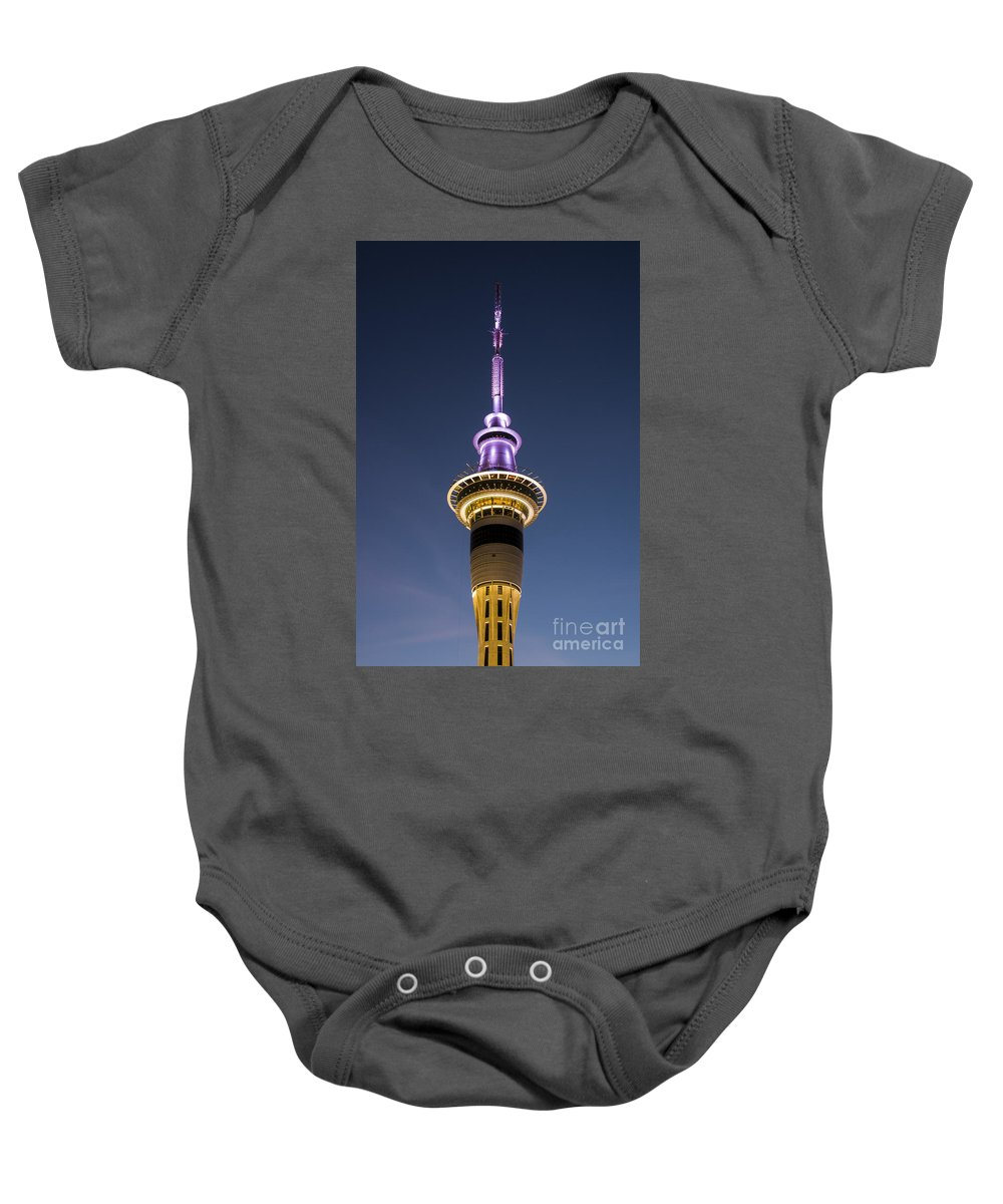 Auckland New Zealand Sky Tower Towers After Dark Architecture Structure Structures Gordon Moller Night Light Lights Baby Onesie featuring the photograph Sky Tower by Bob Phillips