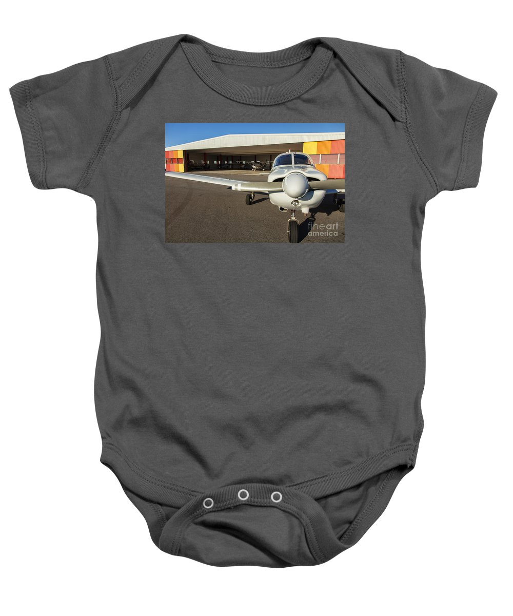 Plane Baby Onesie featuring the photograph Small Planes In Private Airport by Sophie McAulay