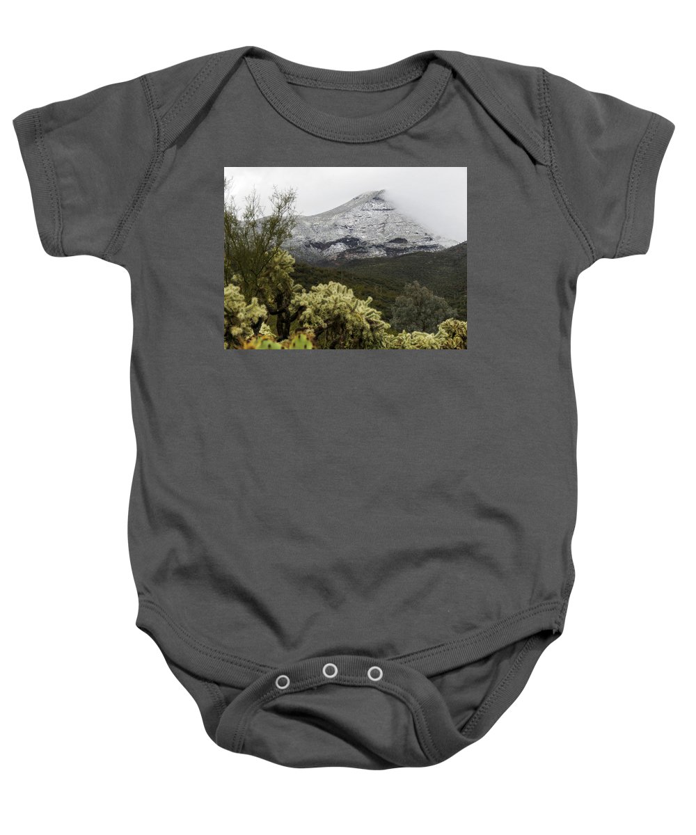 Desert Baby Onesie featuring the photograph Snowy Desert Mountain by Laurel Powell