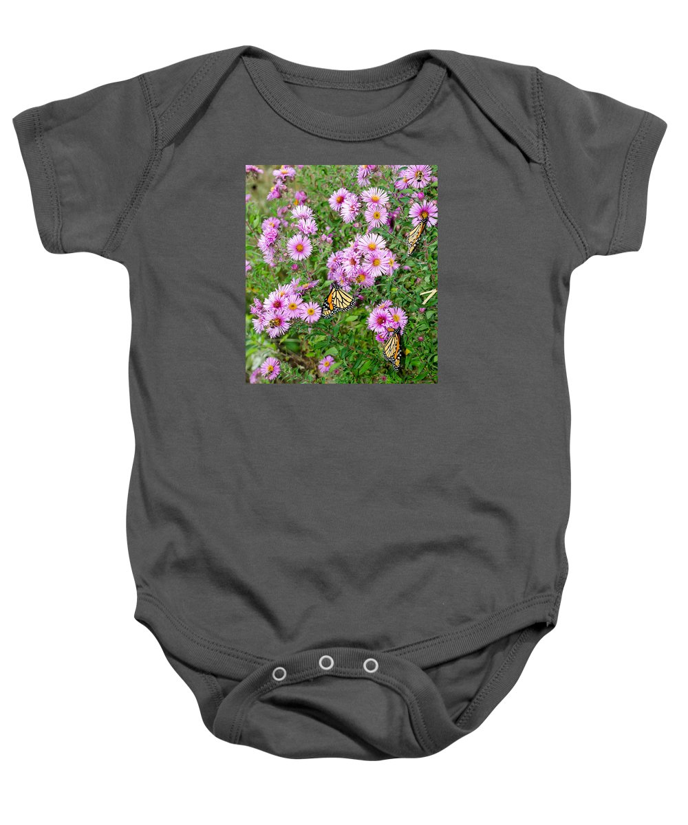 Monarchs Baby Onesie featuring the photograph So Many Wings by Susan McMenamin