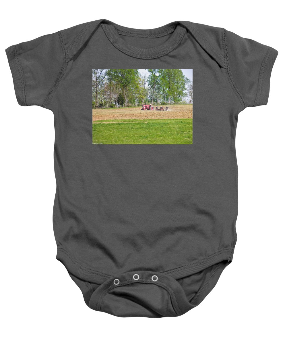 Tractor Baby Onesie featuring the photograph Spring Discing by Nick Kirby