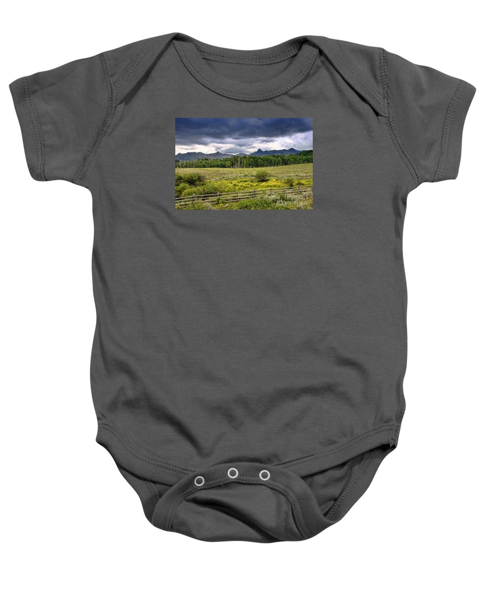 Colorado Baby Onesie featuring the photograph Storm Clouds Over The Rockies by David Perry Lawrence