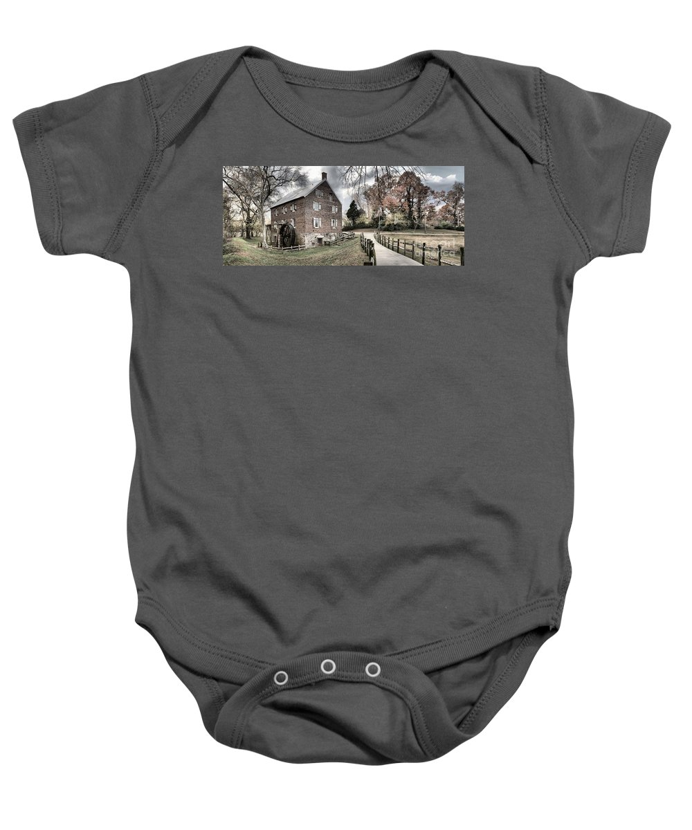 Grist Mill Baby Onesie featuring the photograph Stormy Skies Over The 1823 Grist Mill by Adam Jewell