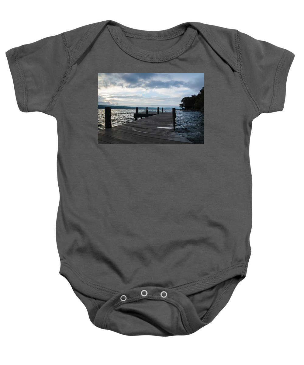 Stormy Baby Onesie featuring the photograph Stormy Sky Over Seneca Lake by Photographic Arts And Design Studio