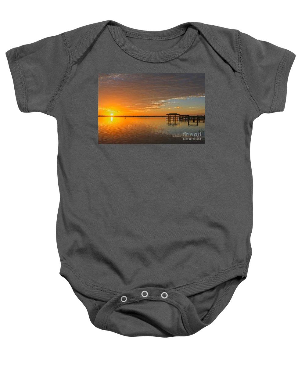 Sunrise Baby Onesie featuring the photograph Sunday Morning Glow by Deborah Benoit