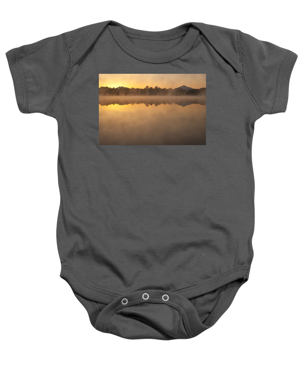 Cascade Mountain Range Baby Onesie featuring the photograph Sunrise In Fog Lake Cassidy With Mount Pilchuck And Reflections by Jim Corwin