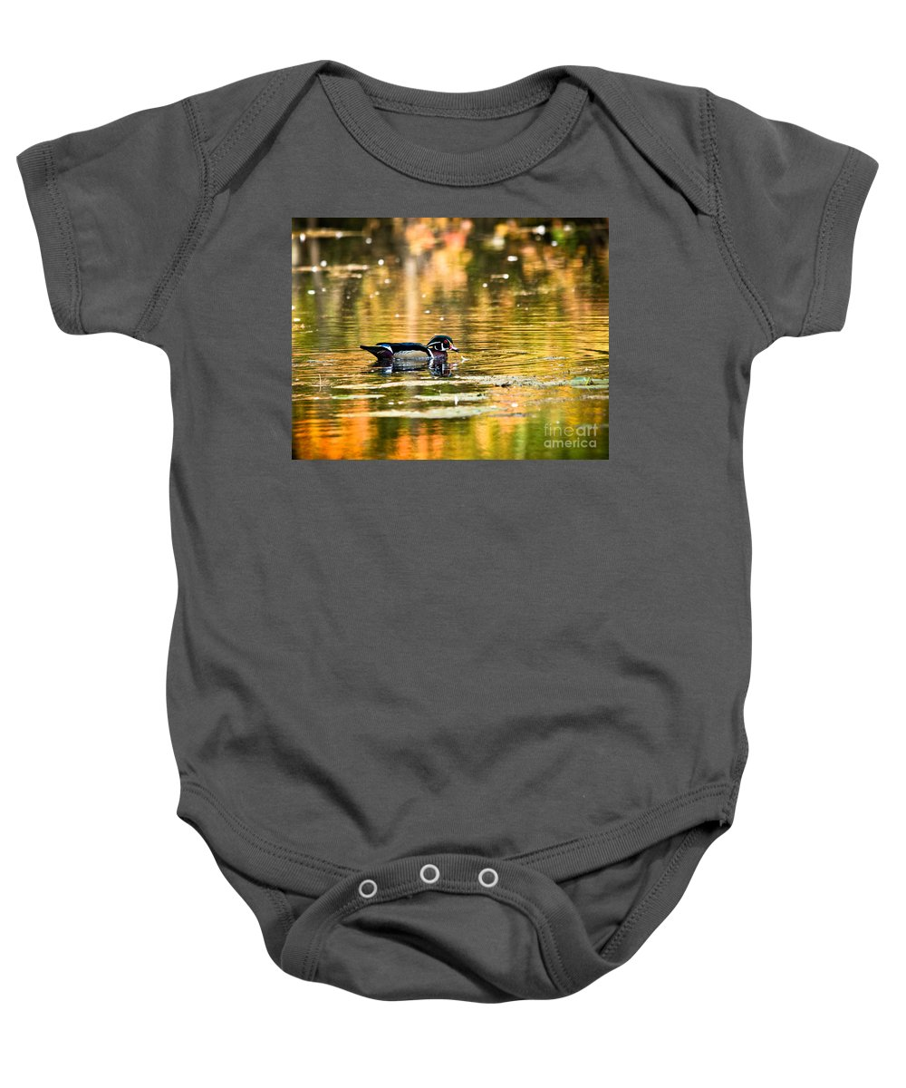 Baby Onesie featuring the photograph Swimming In Gold by Cheryl Baxter