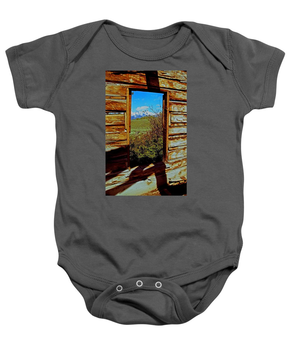 Wyoming Baby Onesie featuring the photograph Tetons Through Log House Window by Rich Walter