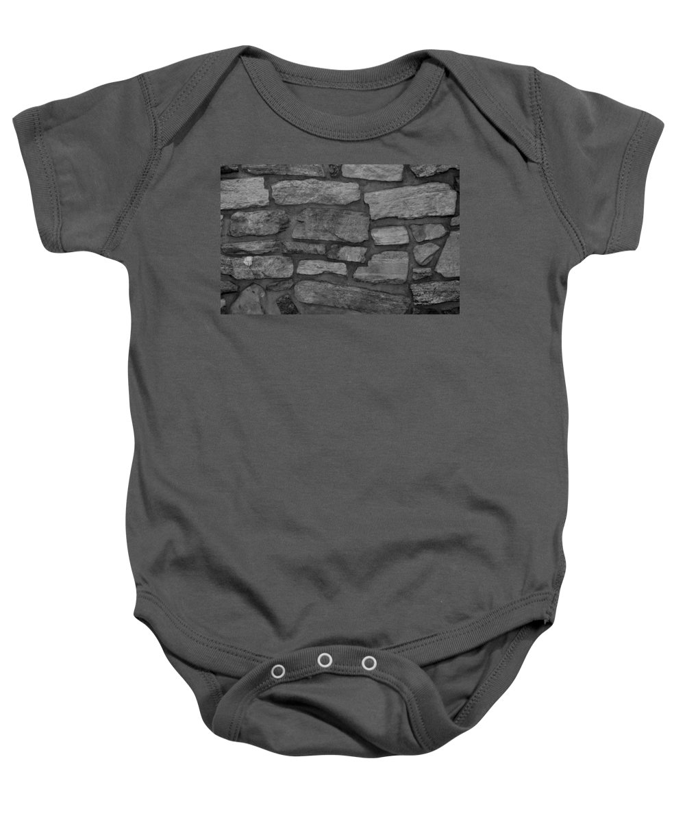 Scenic Baby Onesie featuring the photograph The Battery Wall In Black And White by Rob Hans