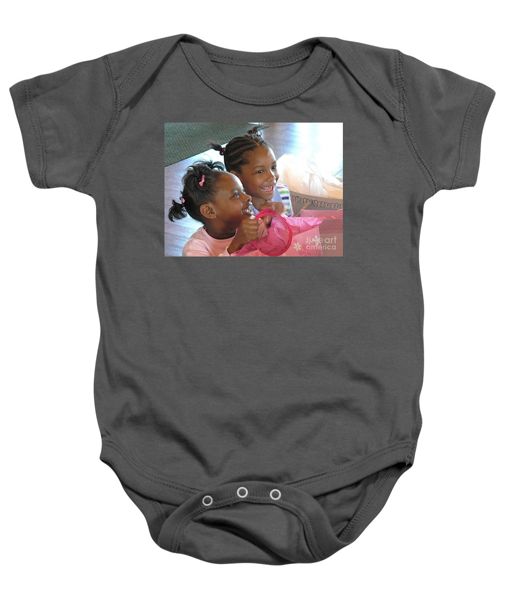 Happy Baby Onesie featuring the photograph The Art Of Giving by Dona Dugay