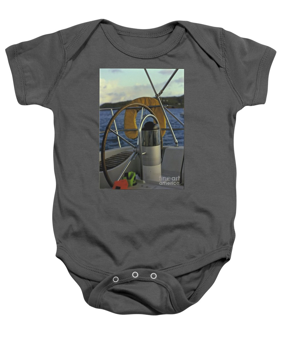 Sail Baby Onesie featuring the photograph The Helm by William Norton