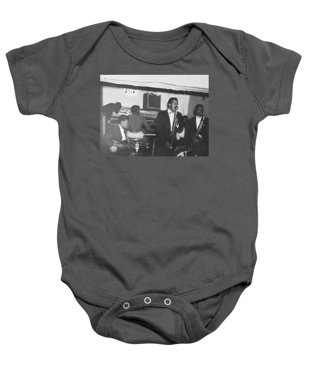 Baby Onesie featuring the photograph The Singer by Don Baker