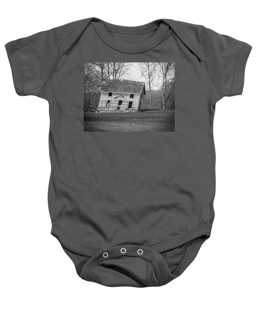 Black And White Baby Onesie featuring the photograph There Was A Crooked House by Ken Kobe
