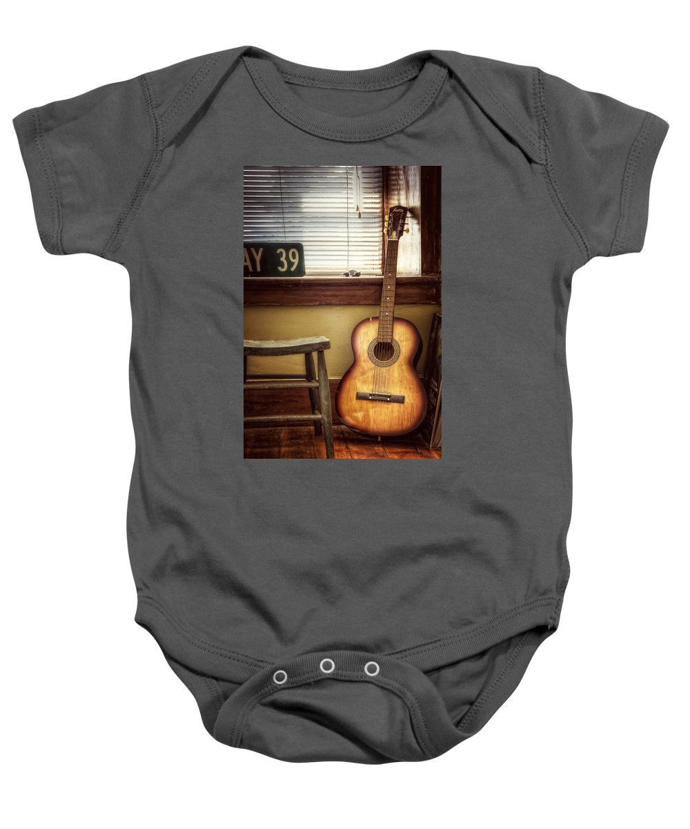 Guitar Baby Onesie featuring the photograph This Old Guitar by Scott Norris