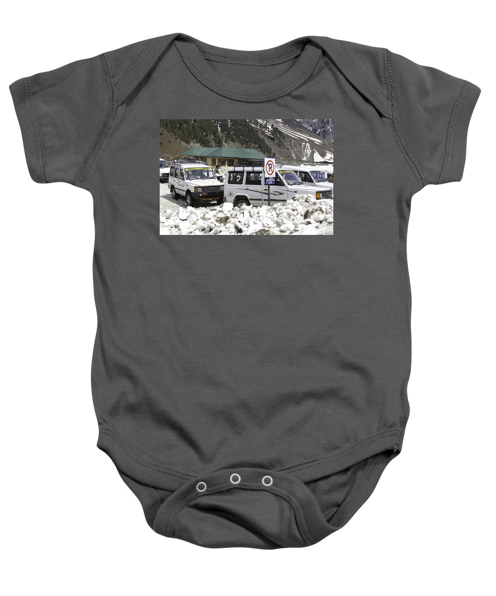 Action Baby Onesie featuring the photograph Tourist Vehicles Parked At The No Parking Sign In Sonmarg by Ashish Agarwal