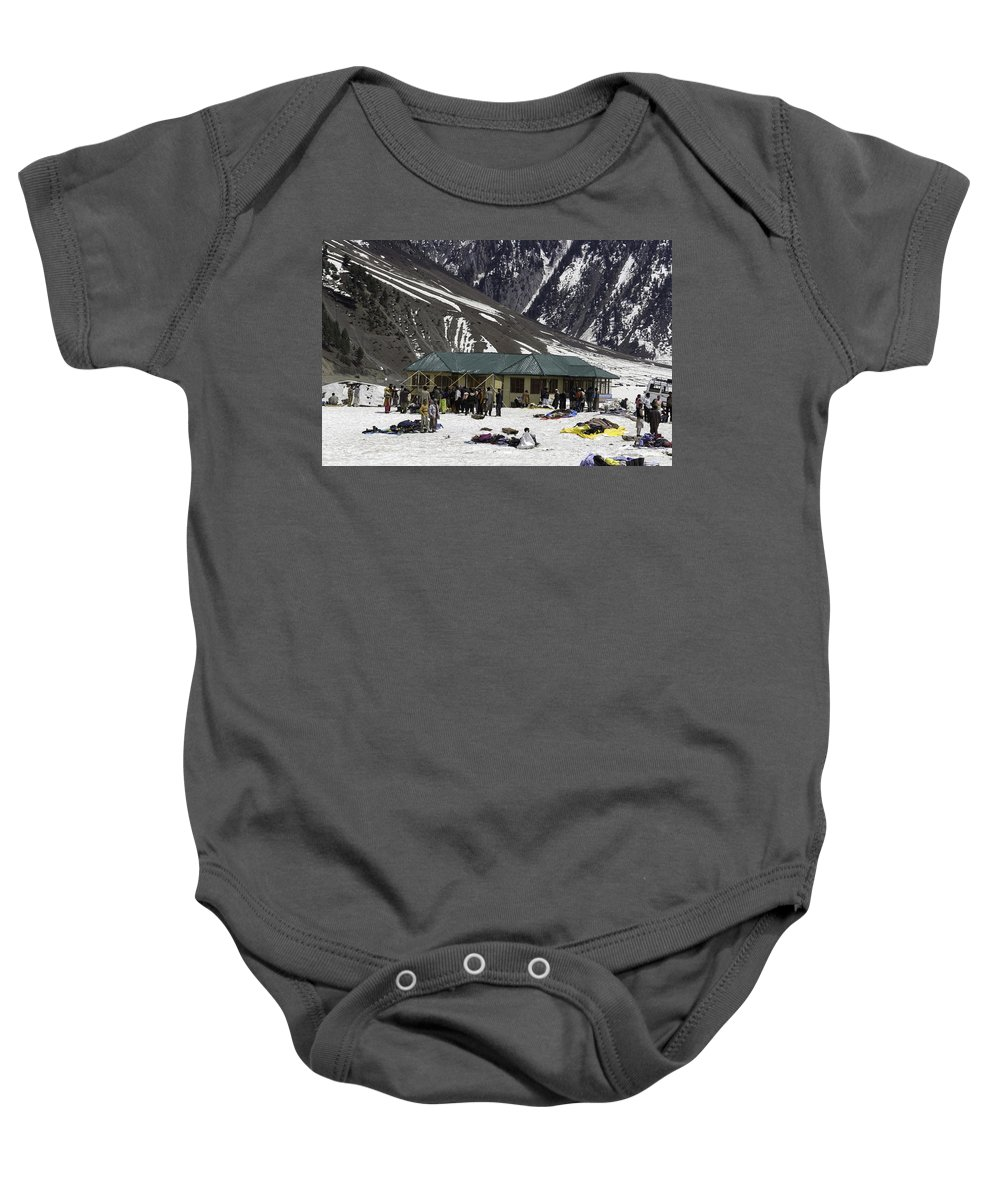 Action Baby Onesie featuring the photograph Tourists Surrounded By Snow And Ice Outside One Of The Few Buildings by Ashish Agarwal