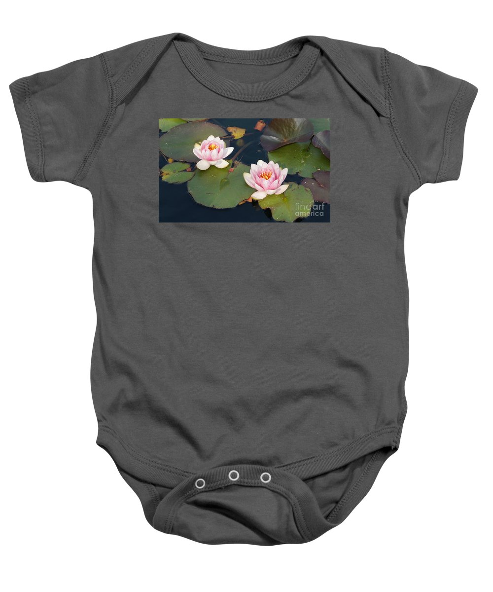 Water Lillies Baby Onesie featuring the photograph Two Water Lillies by Megan Cohen