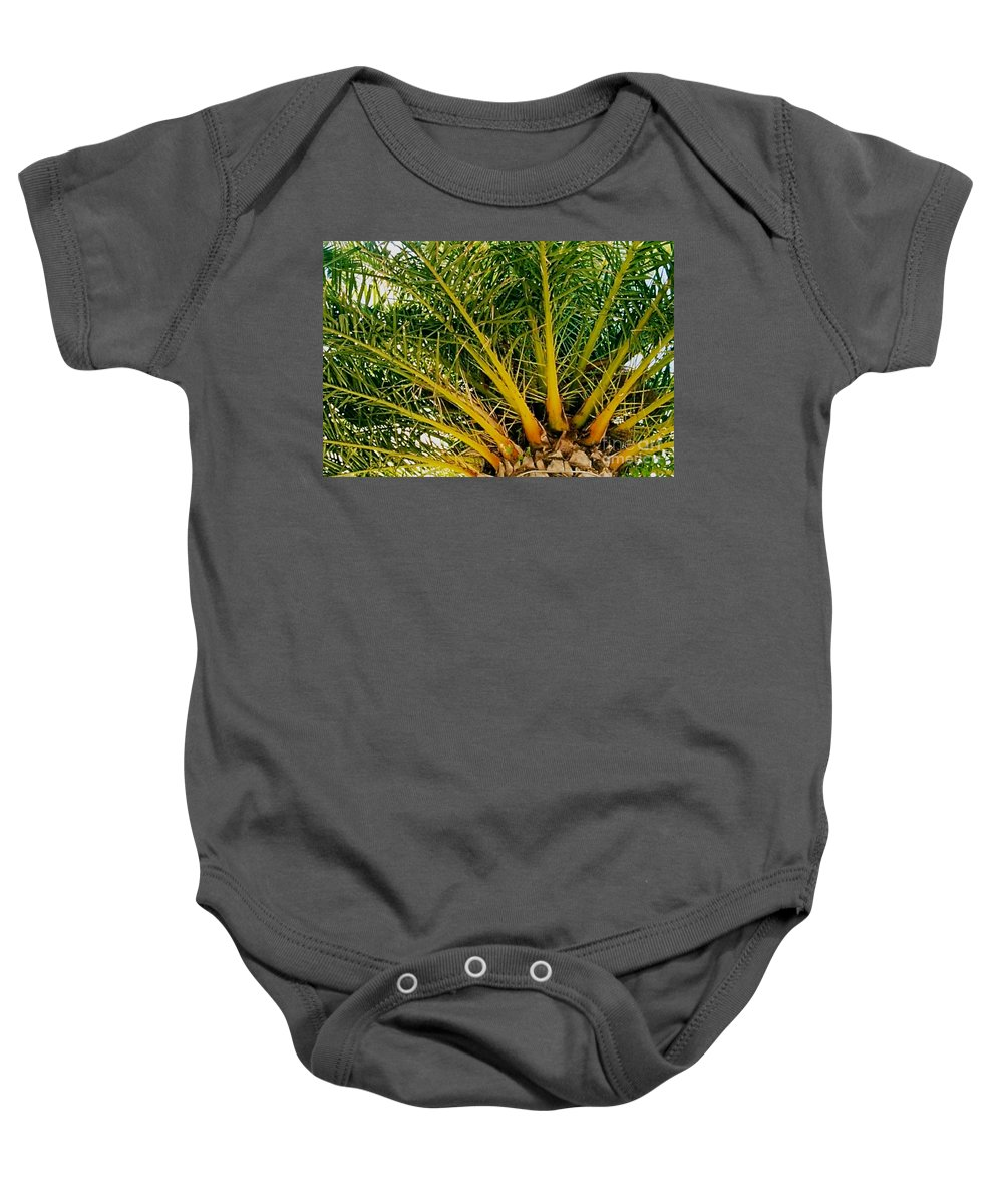 Palm Tree Baby Onesie featuring the photograph Under The Palm by Anita Lewis