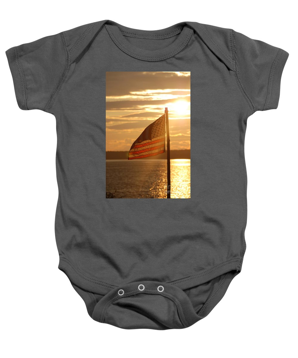 Sunset Baby Onesie featuring the photograph Us Flag At Sunset by DejaVu Designs
