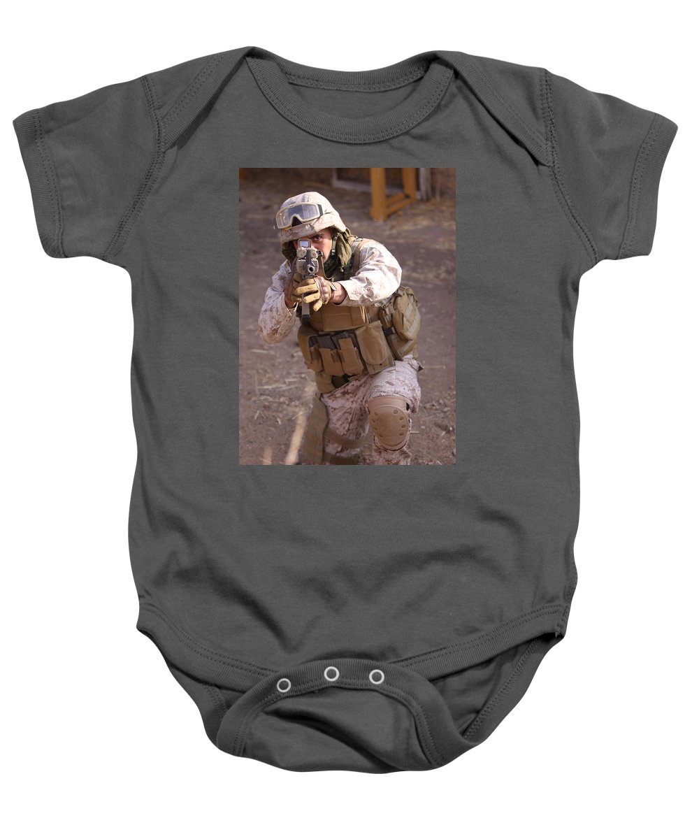 Military Baby Onesie featuring the photograph Us Marine At Work by Shoal Hollingsworth