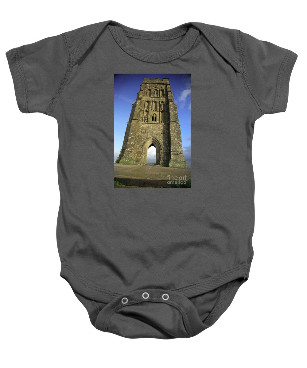 Abandoned Baby Onesie featuring the photograph Vertical View Of Glastonbury Tor by Deborah Benbrook