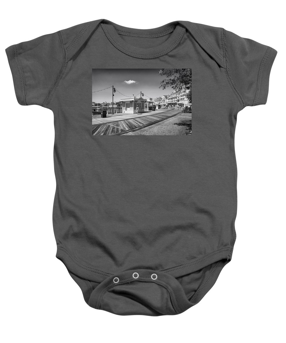 Black And White Baby Onesie featuring the photograph Walking On The Boardwalk In Black And White Walt Disney World by Thomas Woolworth
