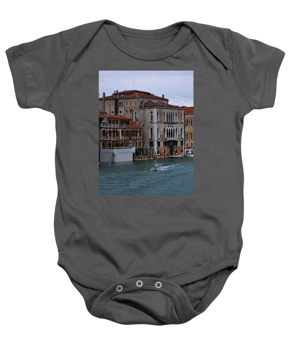 Building Baby Onesie featuring the photograph Water Taxi In Venice by Richard Booth