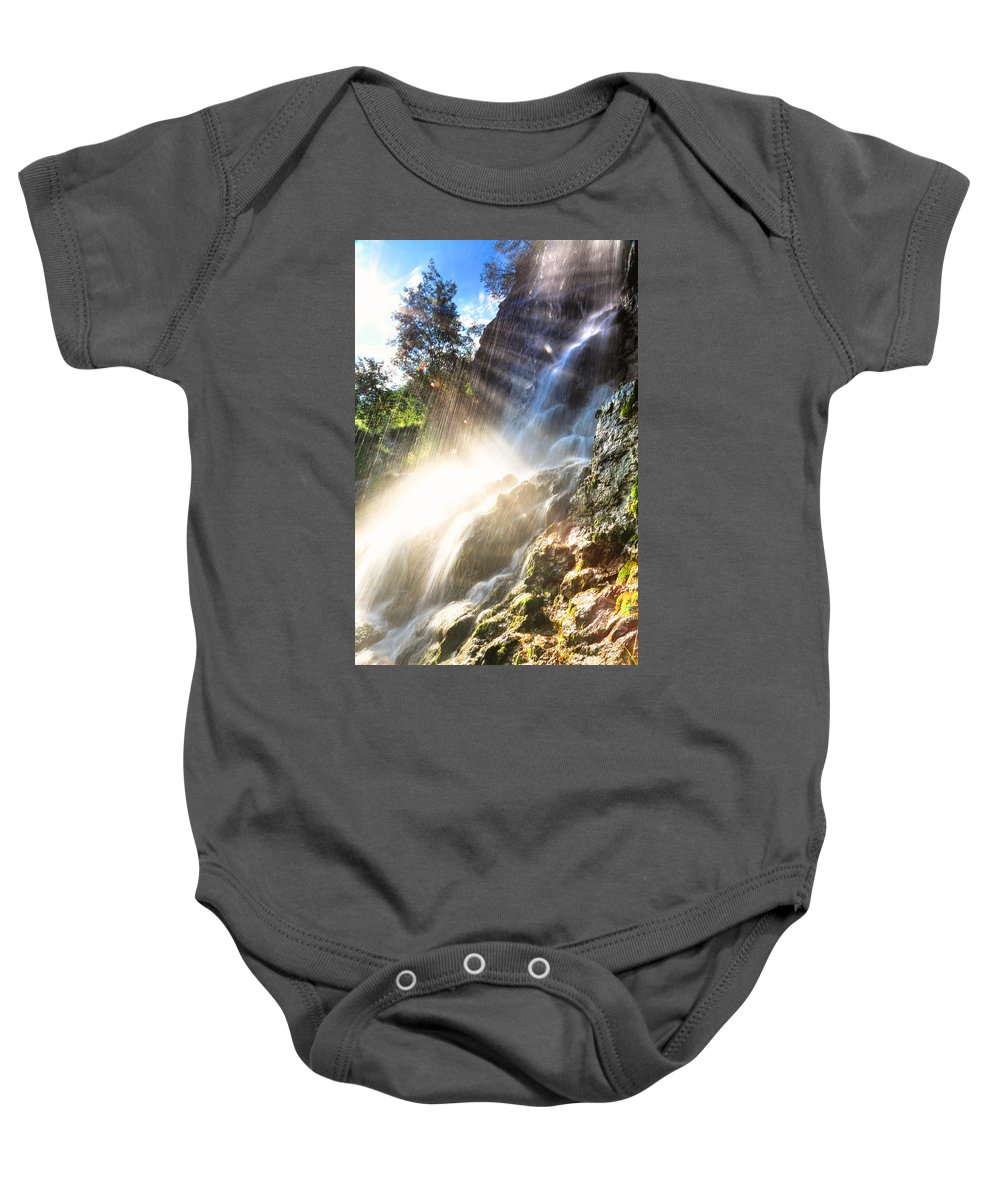 Motion Baby Onesie featuring the photograph Where The Light Meets The Water by Eti Reid