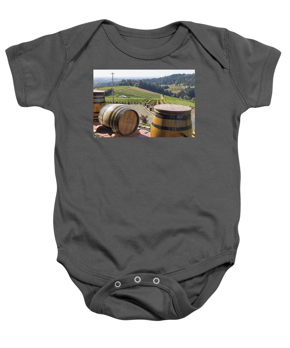 Wine Baby Onesie featuring the photograph Wine Barrels In Vineyard by Jit Lim
