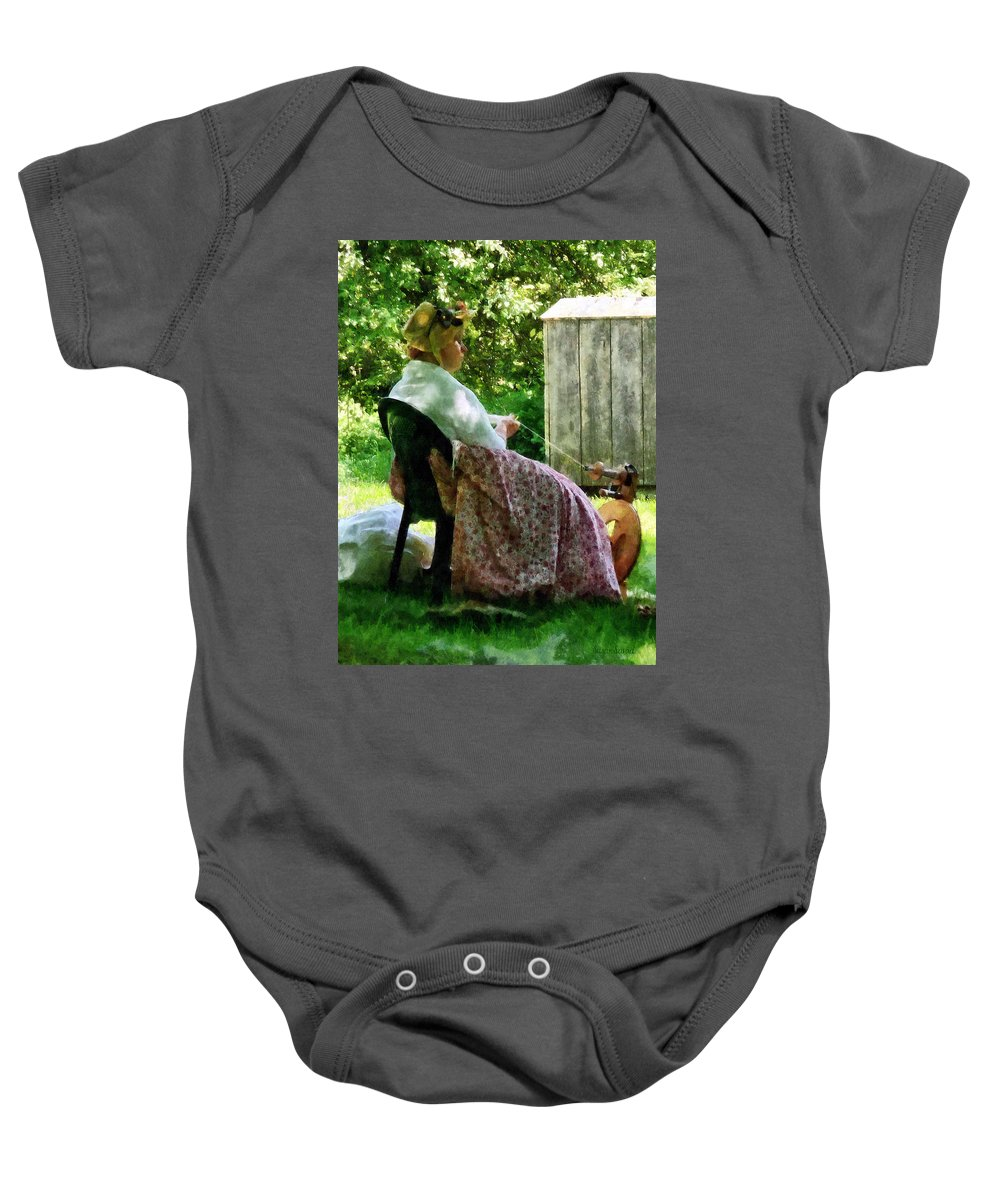 Woman Baby Onesie featuring the photograph Woman Spinning Wool by Susan Savad