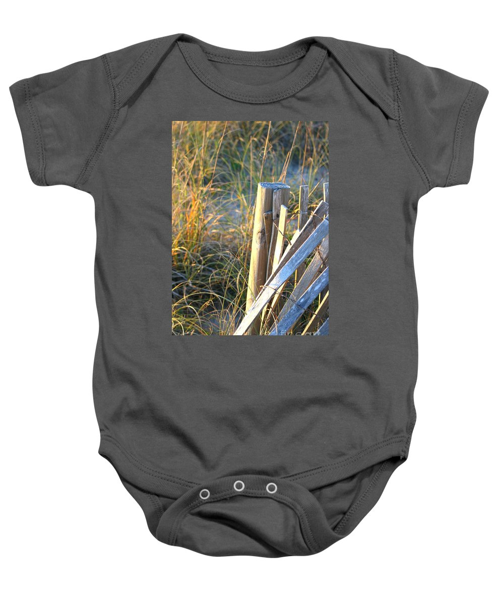 Post Baby Onesie featuring the photograph Wooden Post And Fence At The Beach by Nadine Rippelmeyer