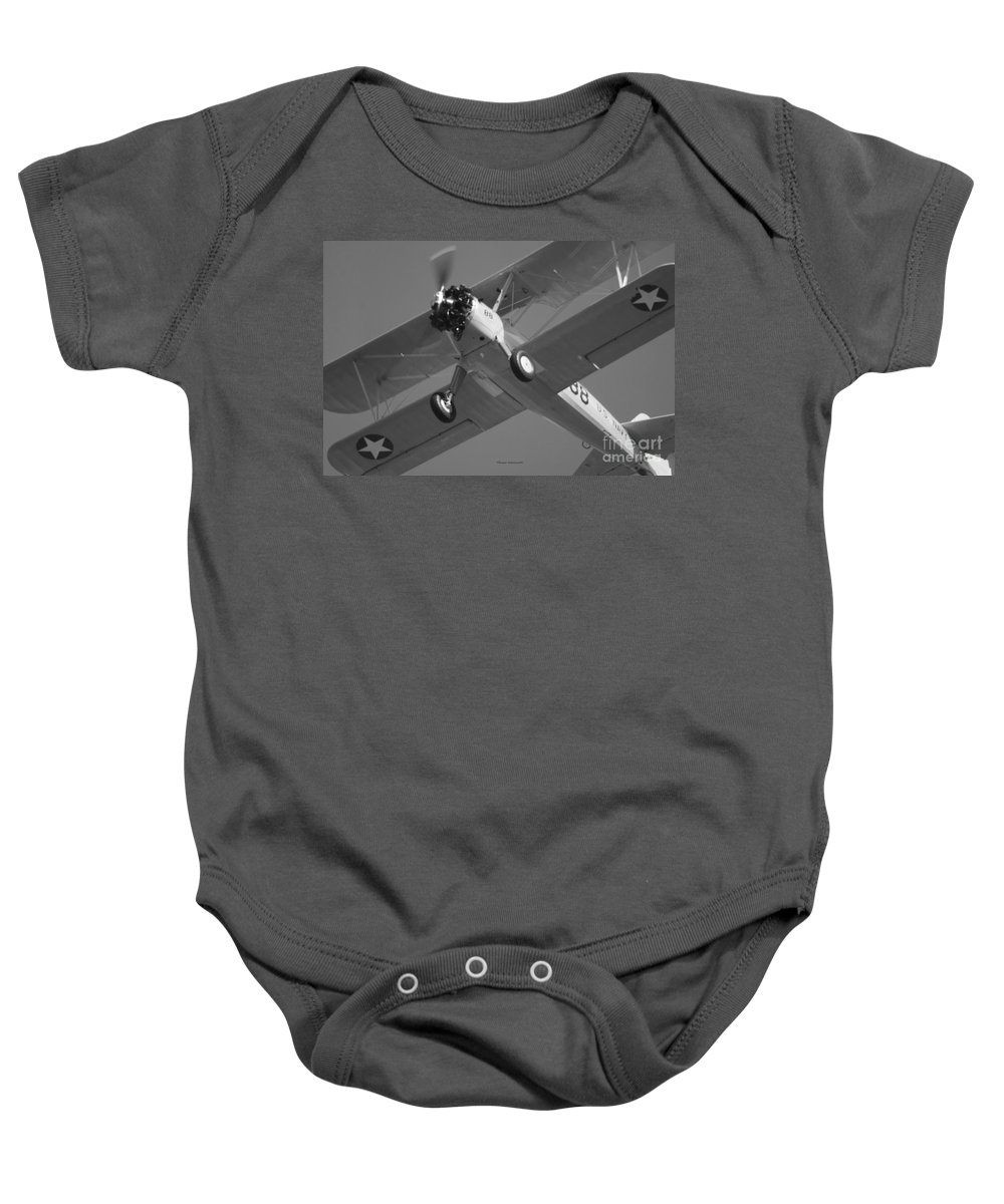 Black And White Baby Onesie featuring the photograph Stearman Trainer Bi Plane Black And White by Thomas Woolworth