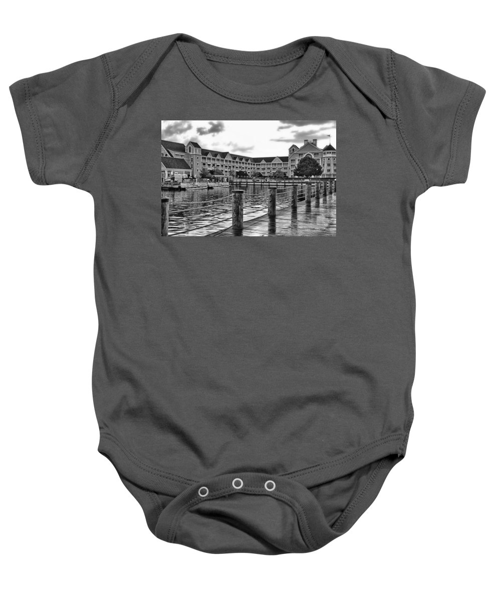 Black And White Baby Onesie featuring the photograph Yacht And Beach Club After The Rain In Black And White Walt Disney World by Thomas Woolworth