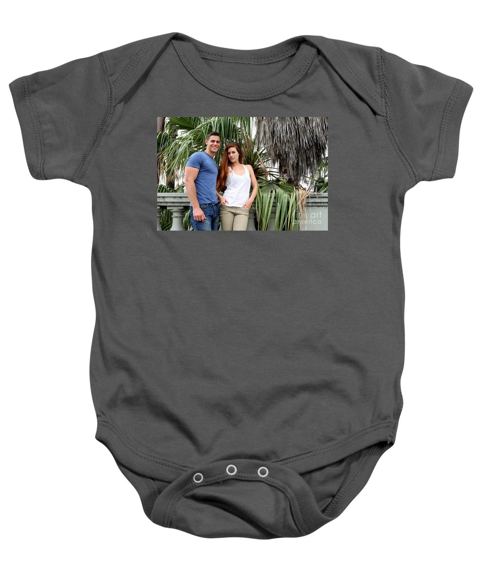 Woman Baby Onesie featuring the photograph Young Couple Palm Tree by Henrik Lehnerer