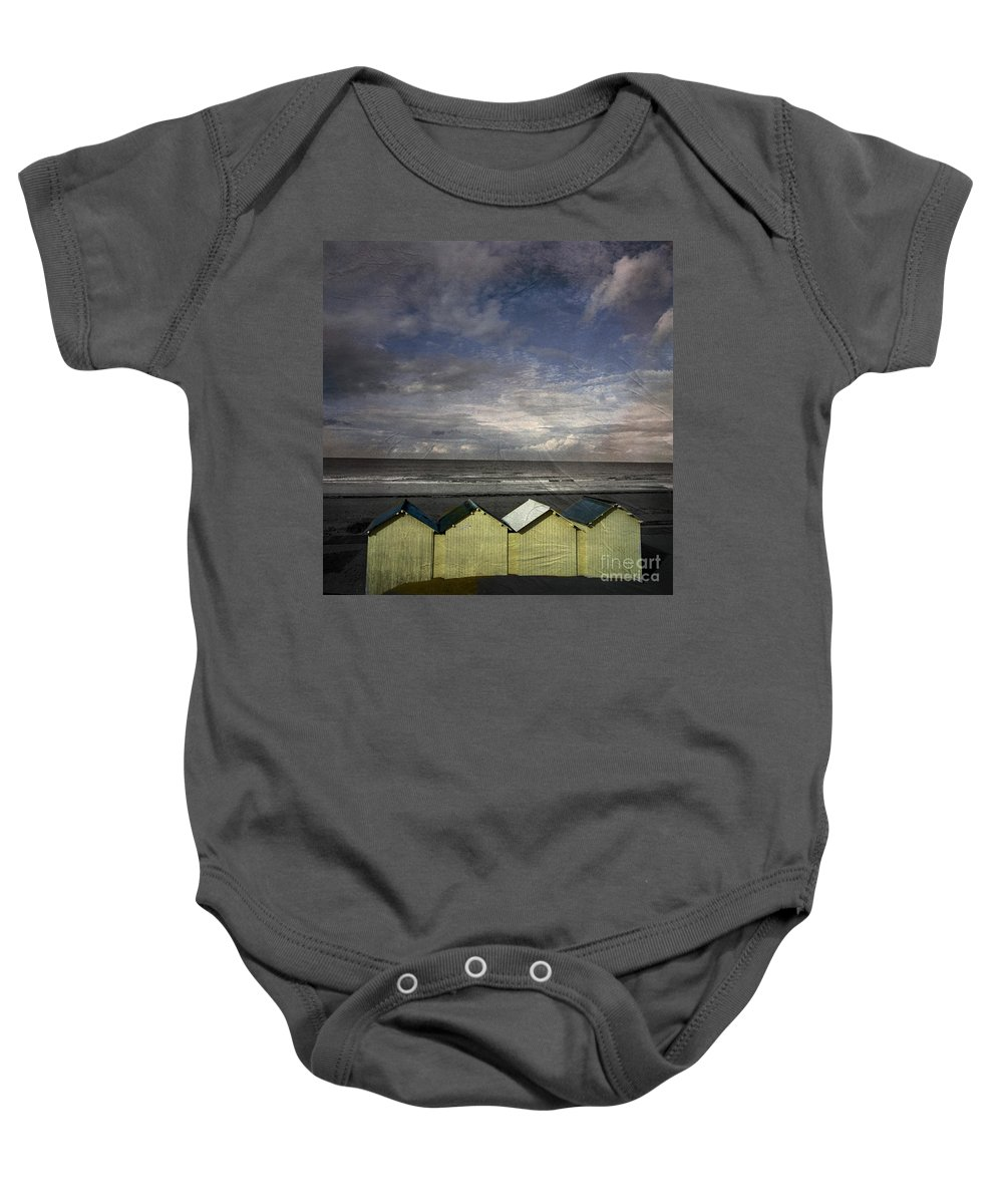 Yellowed Baby Onesie featuring the photograph Beach Huts Under A Stormy Sky Vintage-look. Normandy. France by Bernard Jaubert
