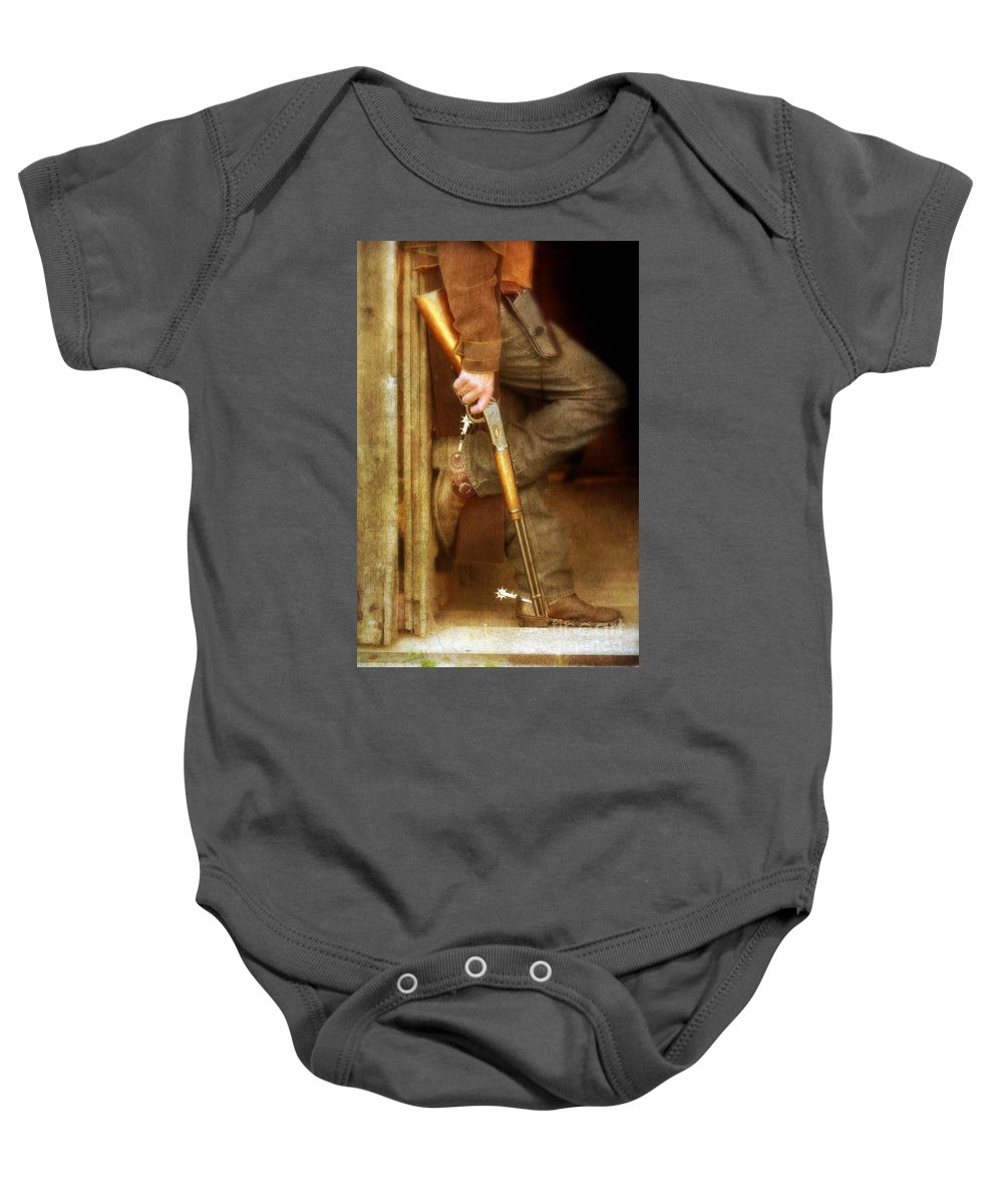 Cowboy Boots Baby Onesie featuring the photograph Cowboy With Guns by Jill Battaglia