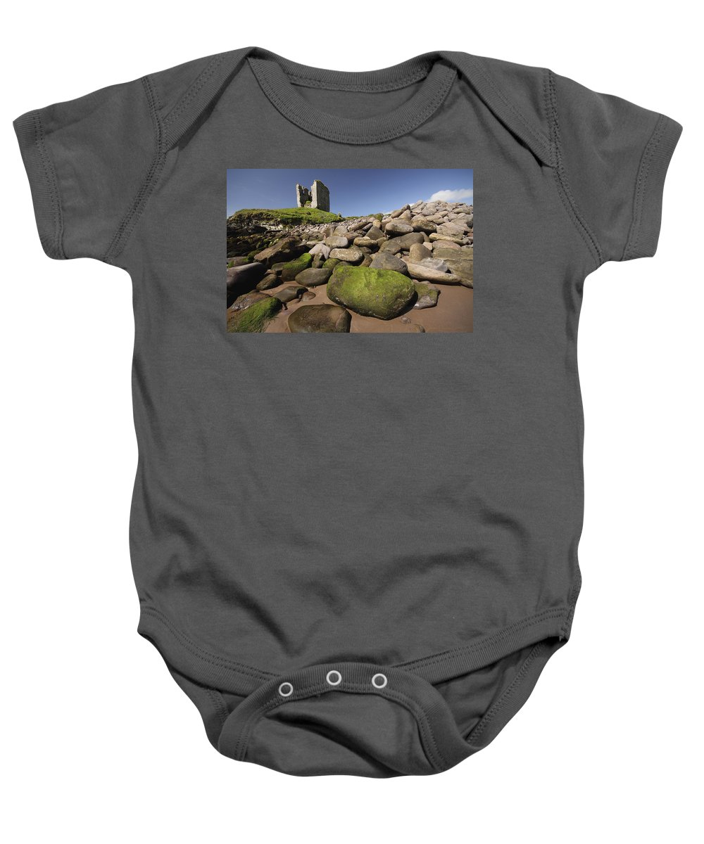 Blue Sky Baby Onesie featuring the photograph Minard Castle And Rocky Beach Minard by Trish Punch