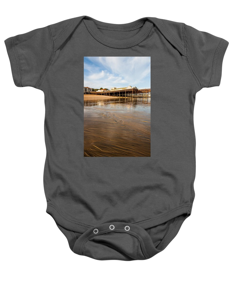 Beach Baby Onesie featuring the photograph Hastings Pier by Dawn OConnor