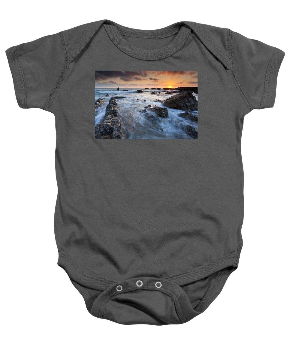 Beach Baby Onesie featuring the photograph Sunset by Sebastian Wasek