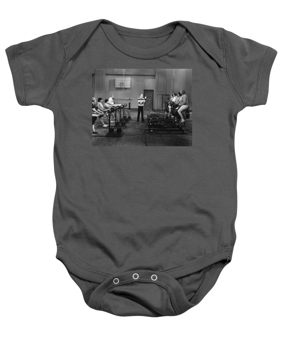 -weight & Exercise- Baby Onesie featuring the photograph Silent Still: Exercise by Granger