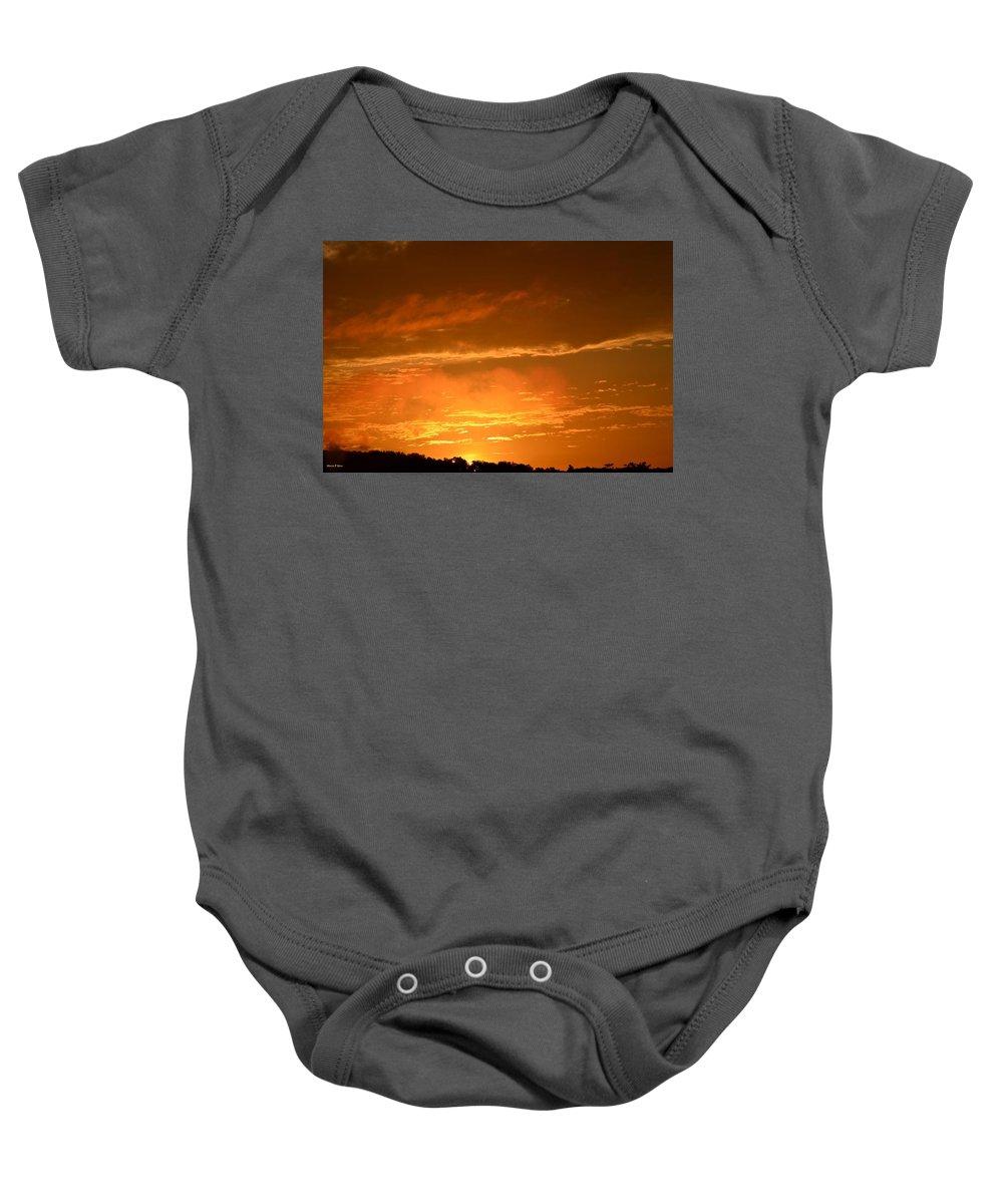 Peeking Baby Onesie featuring the photograph A Peeking Sunrise by Maria Urso