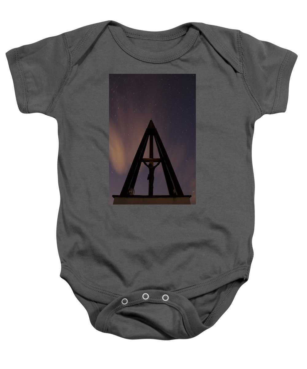 Startrails Baby Onesie featuring the photograph Against The Stars by Ian Middleton