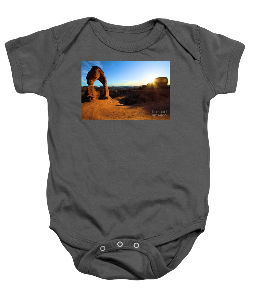 Delicate Arch Baby Onesie featuring the photograph Arches Starburst by Adam Jewell
