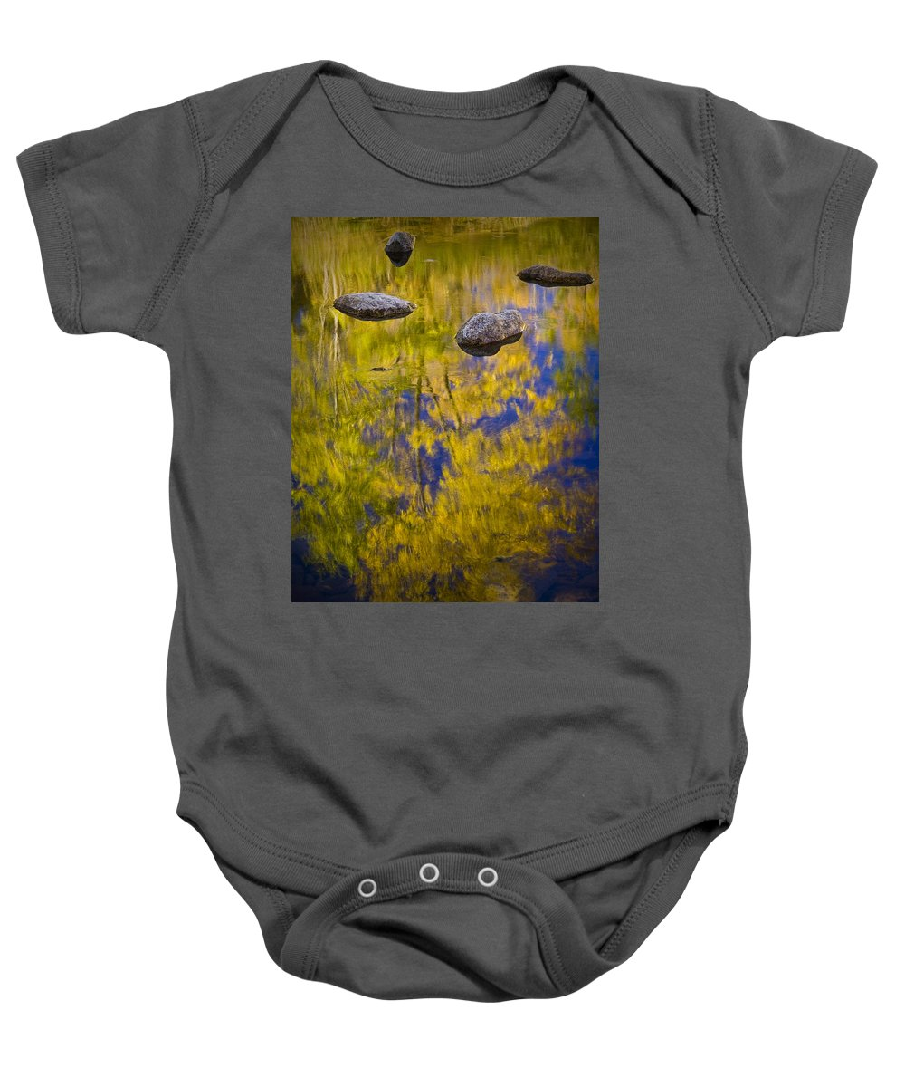 Art Baby Onesie featuring the photograph Autumn Tree Reflections With Rocks On The Muskegon River by Randall Nyhof